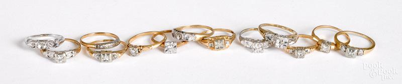 Thirteen 14K gold and diamond rings
