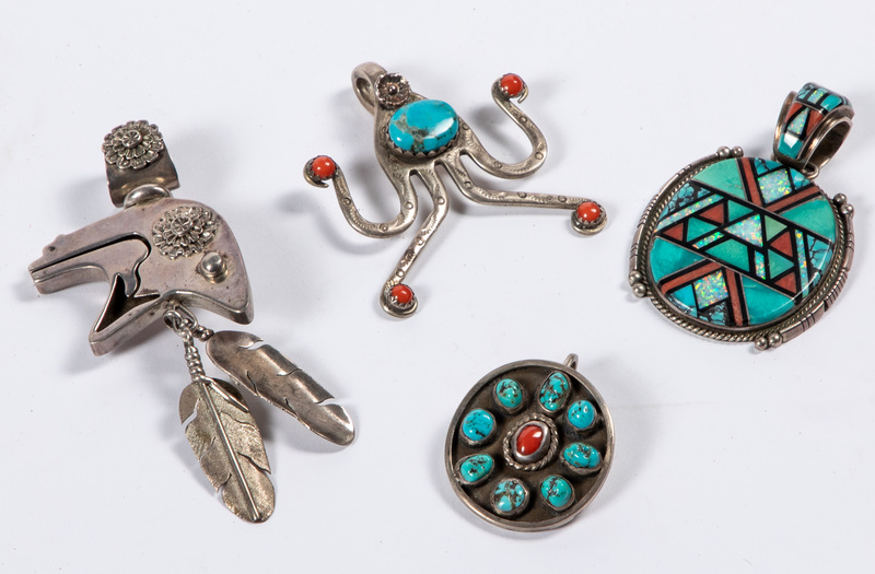 Four Native American Indian pendants