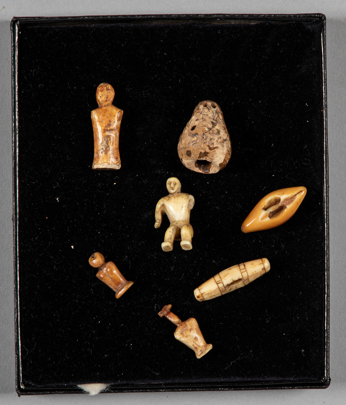 Group of carved ivory Eskimo dolls, to include on