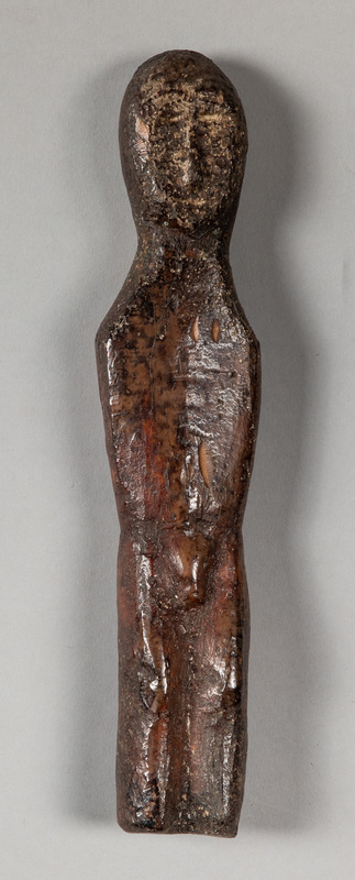 Punuk Eskimo fossilized walrus ivory male figure,