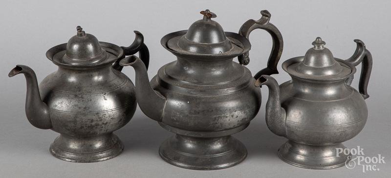 Three American pewter teapots, 19th c.