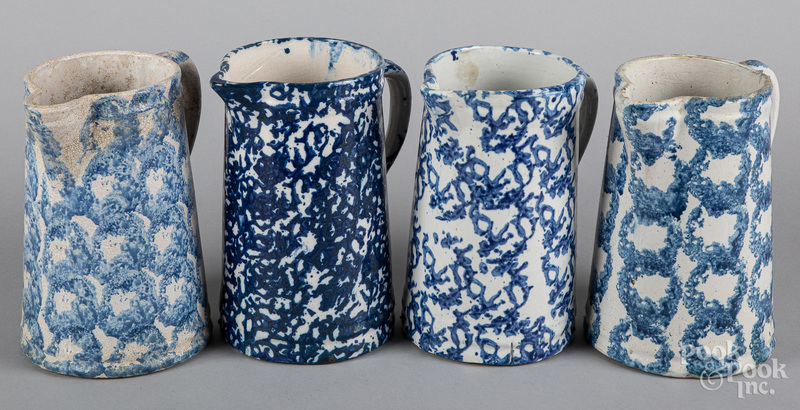 Four blue spongeware pitchers, 19th c.
