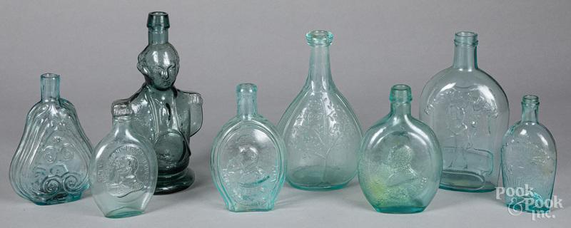 Historical aquamarine glass bottles and flasks