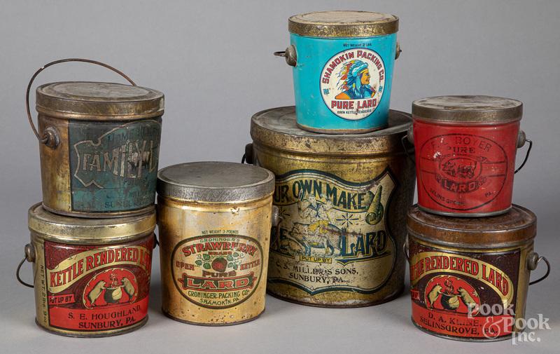 Seven lard advertising tins