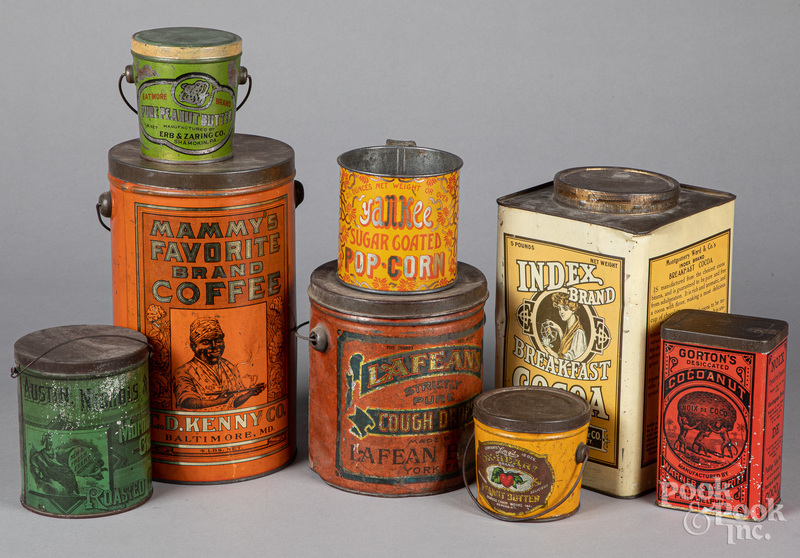 Eight advertising tins