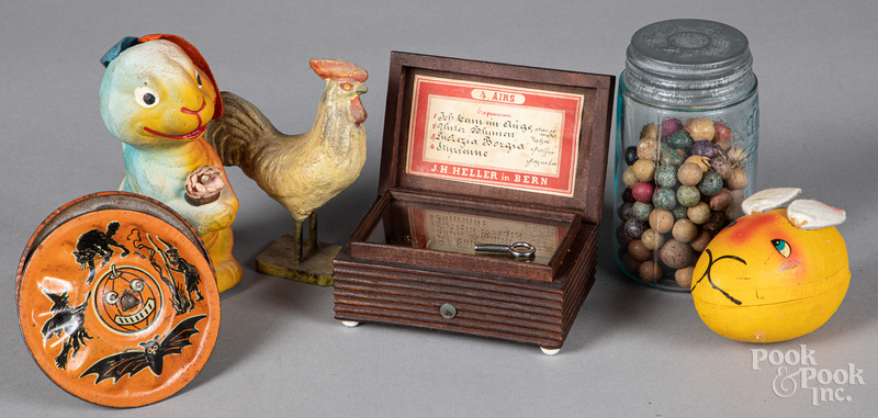 Holiday toys, clay marbles, music box, etc.