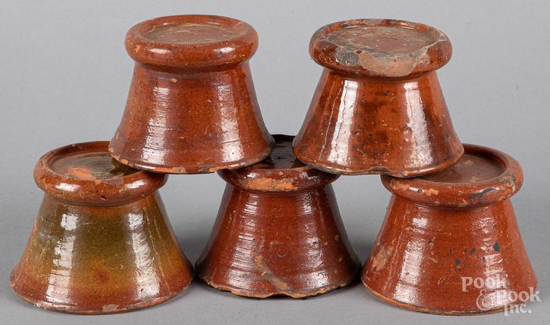 Five redware stove feet, 19th c.