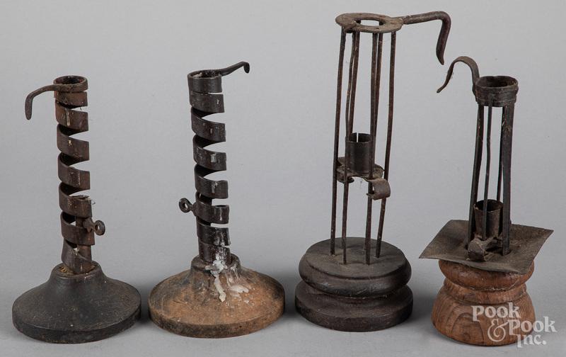 Four tin, iron, and wood candlesticks