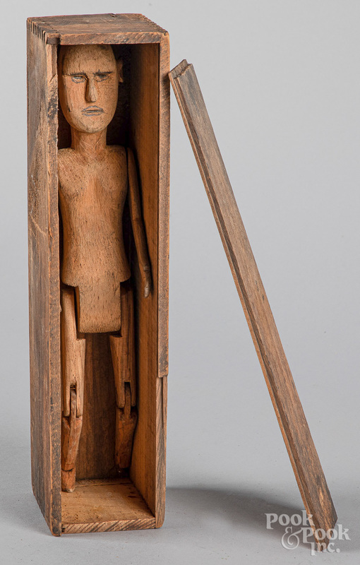 Carved and jointed wooden figure of a gentleman