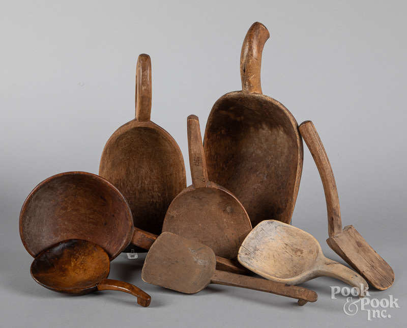 Collection of wooden scoops and butter paddles