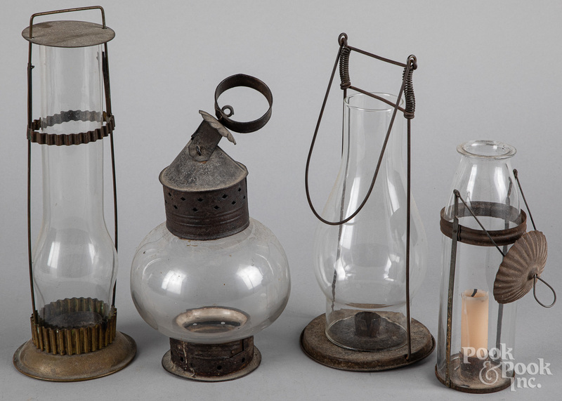 Four tin and glass carry lanterns, 19th c.