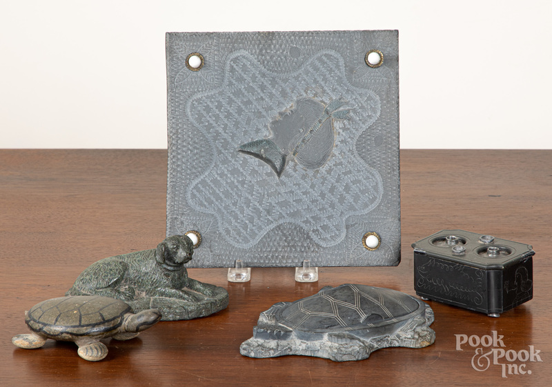 Group of carved slate and stone items