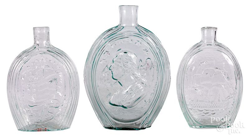Three Historical aquamarine glass flasks