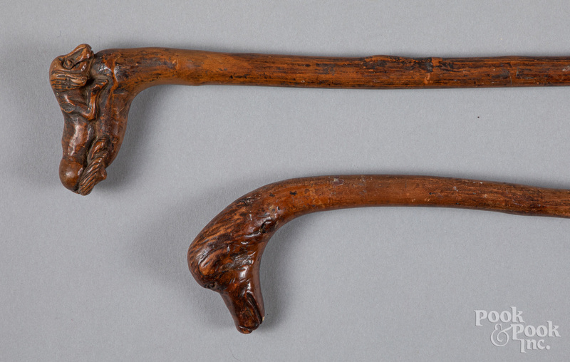 Two carved canes, ca. 1900