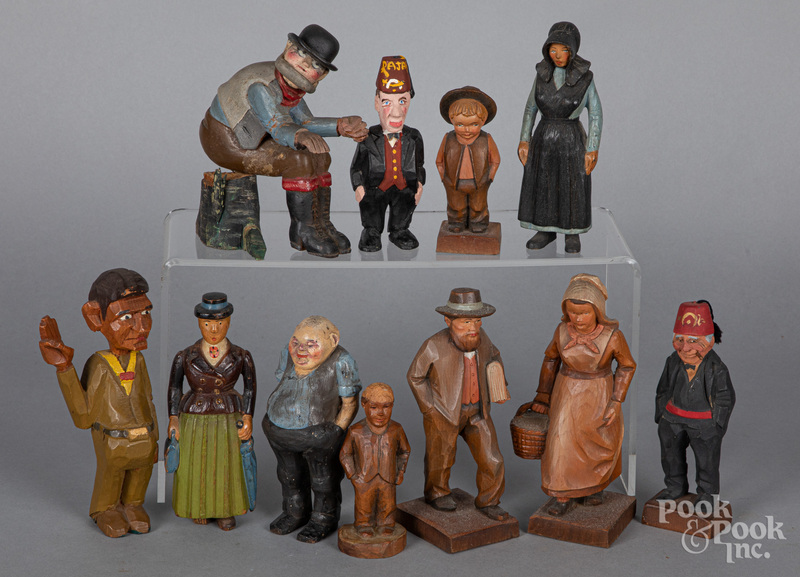 Group of carved and painted pine figures