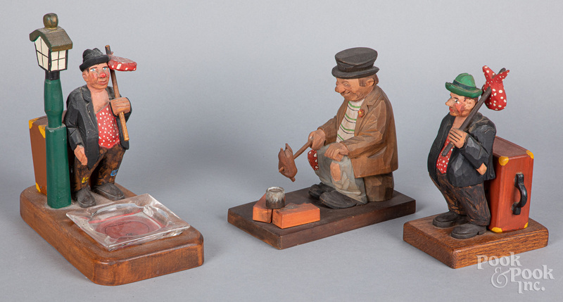 Three carved and painted hobo figures