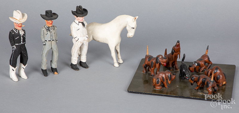 Three carved and painted cowboys, etc.