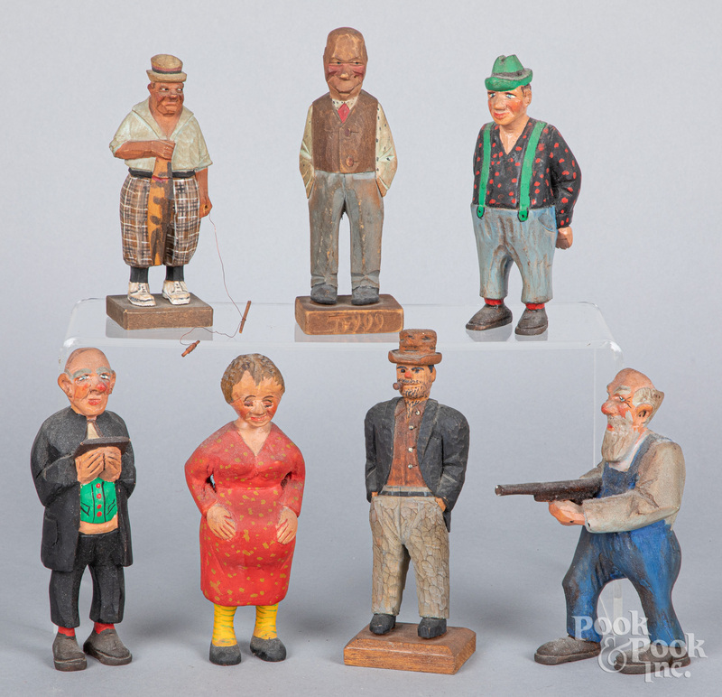 Seven carved and painted figures