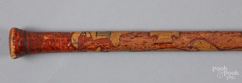 Carved and painted cane, early 20th c.