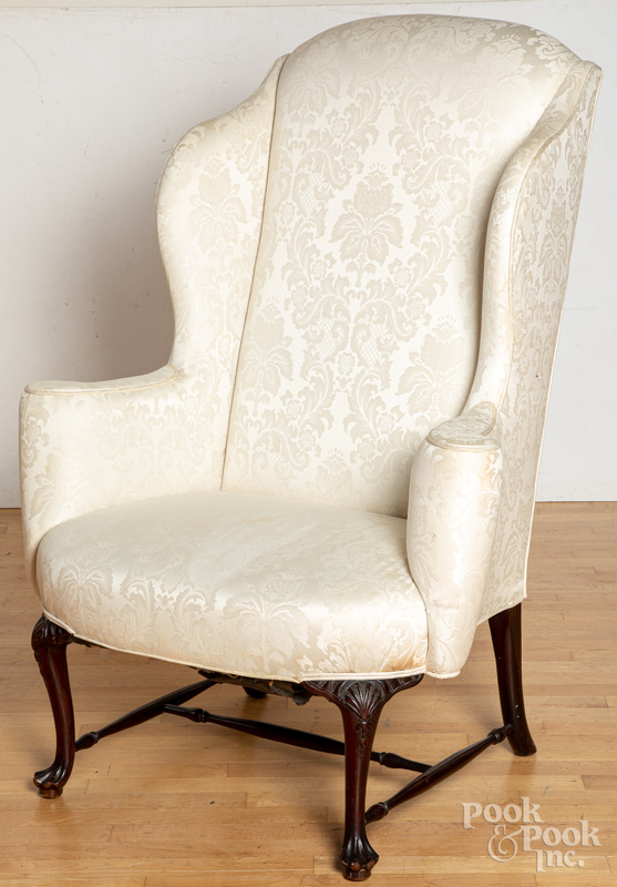 Queen Anne style mahogany wing chair.