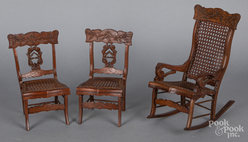 Set of three carved oak doll chairs, ca. 1900