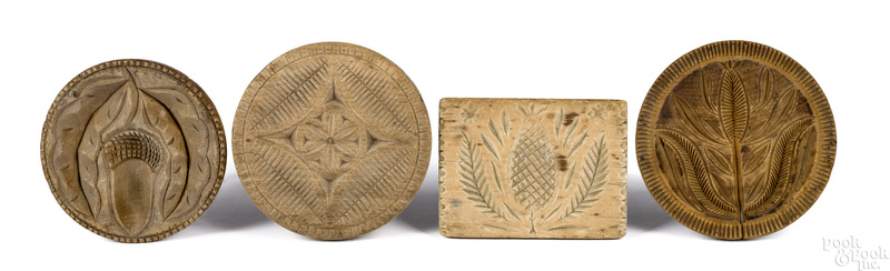 Four carved butterprints