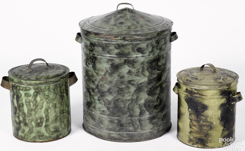 Three green smoke decorated tin bins
