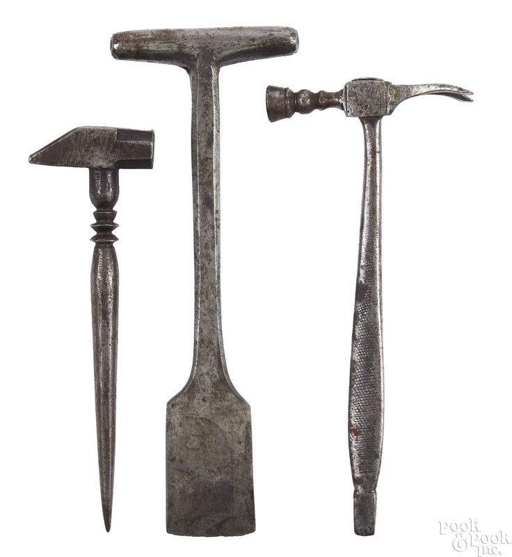 Three wrought iron button hole cutters and hammer