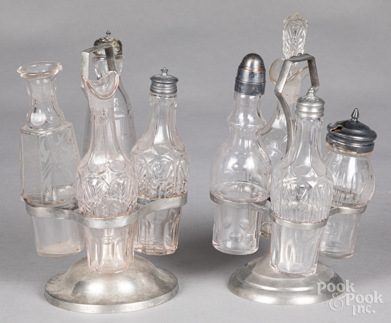 Two pewter cruet stands