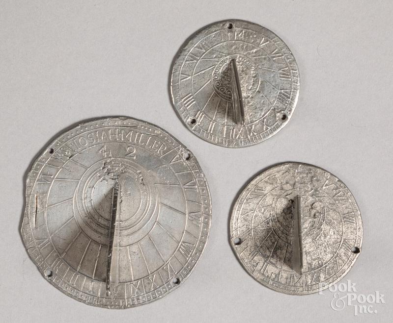 Three pewter sundials