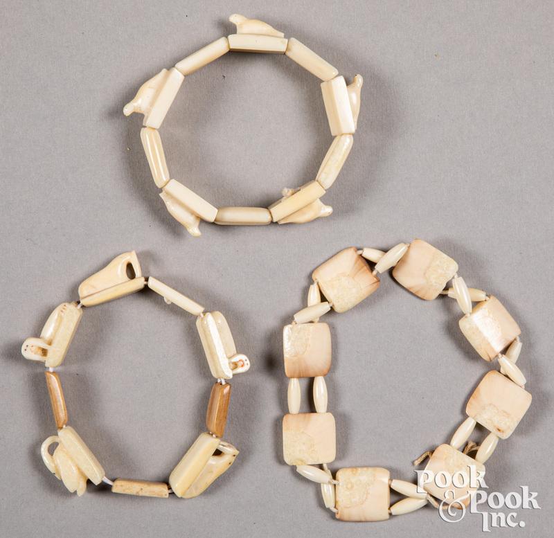Three Eskimo walrus carved bracelets