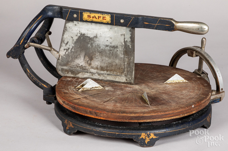 Cast iron and wood country store cheese cutter