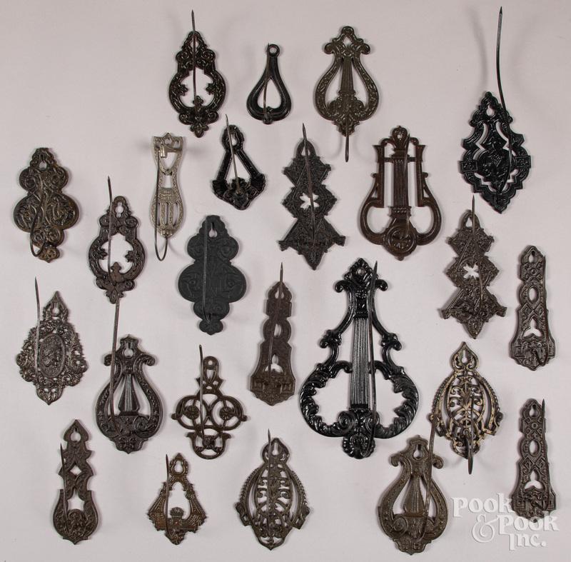 Twenty-four cast iron bill file/receipt hooks