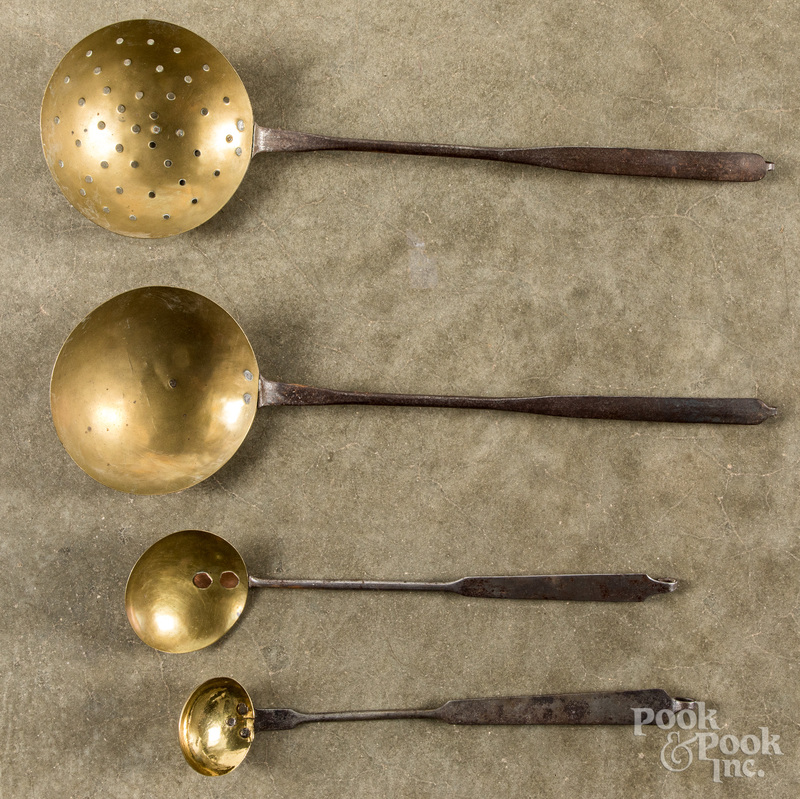 Four wrought iron and brass ladles, 19th c.