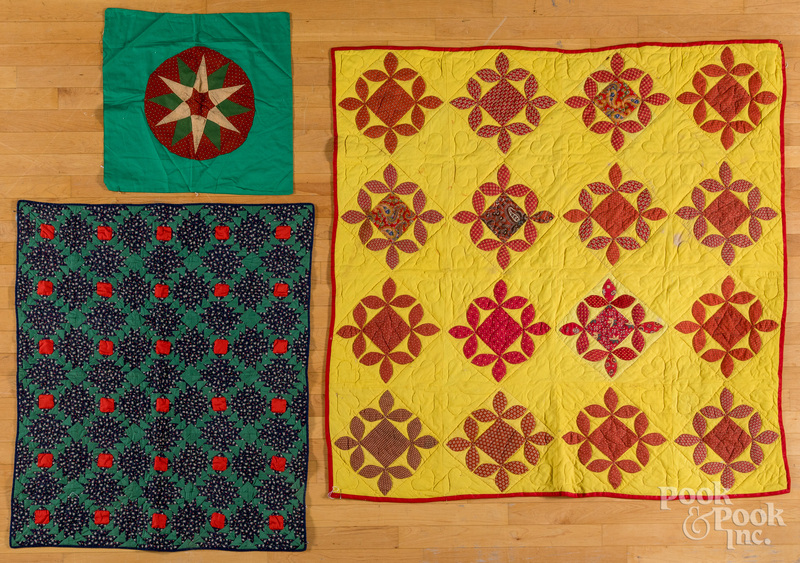 Two crib quilts and a pillow cover