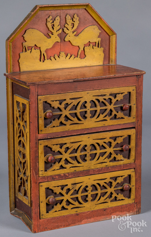Painted doll-size fretwork chest of drawers