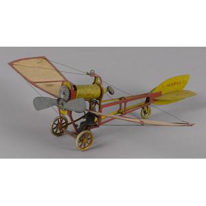 Lehmann tin lithograph clockwork Ikarus airplane,