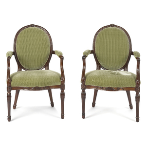 Pair of George III carved mahogany armchairs, late