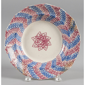 Blue and red sponge spatter soup bowl with star de