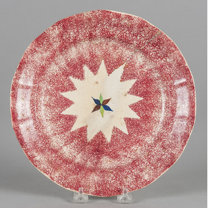 Red spatter plate with star decoration, 9 1/2