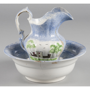 Blue spatter pitcher and basin with fort decoratio