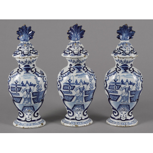 Three Delft garniture vases and covers, 18th/19th.