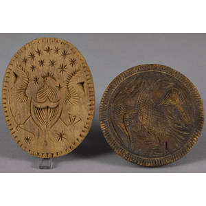 Two carved and turned eagle butterprints, 19th c.,