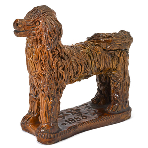 Large Pennsylvania redware poodle, dated 1883, wit