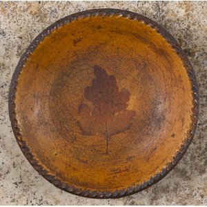 Pennsylvania redware pie plate, early 19th c., wit