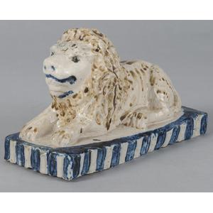 Pennsylvania or Ohio stoneware recumbent lion, 19t