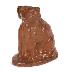 Pennsylvania redware figure of a seated dog, 19th.