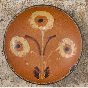 Pennsylvania redware pie plate, 19th c., with thre