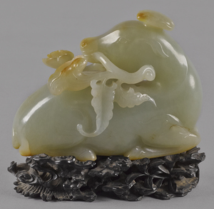 Chinese carved celadon and russet jade horse