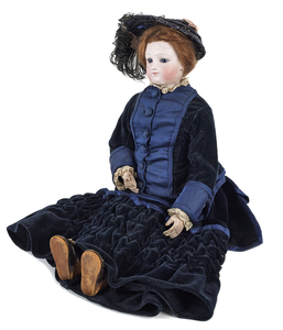 French bisque head and shoulder doll with a socket